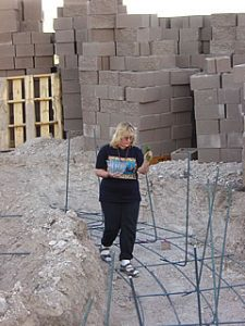 Photo of Arlene aspersing the foundations