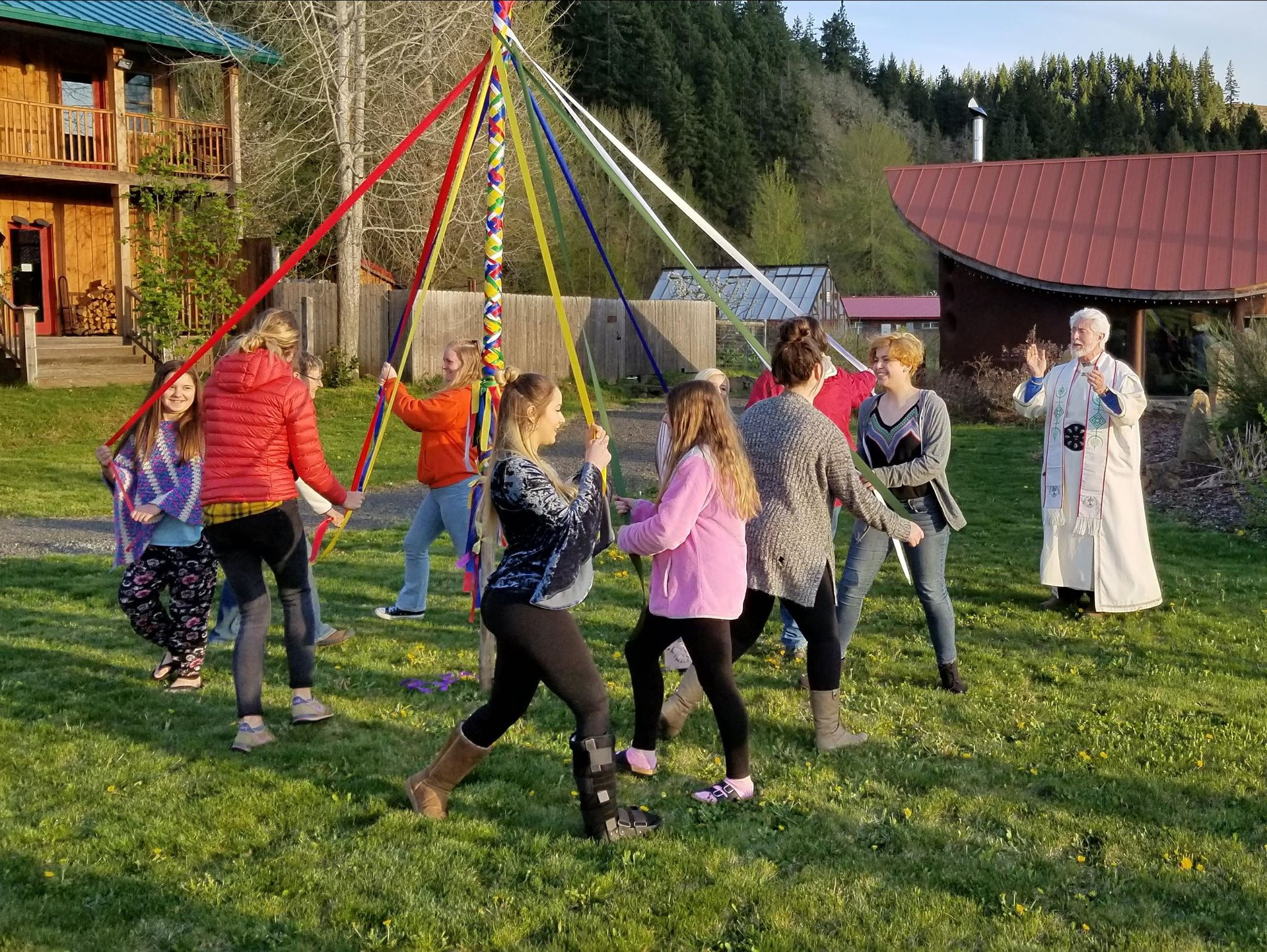 Photo of children dancing the Maypole